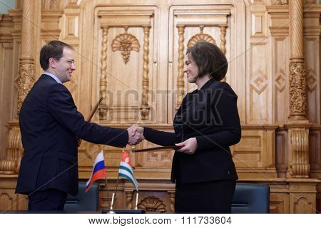 ST. PETERSBURG, RUSSIA - DECEMBER 15, 2015: Russian Minister of culture Vladimir Medinsky (left) and Minister of culture of Abkhazia Elvira Arsalia signs the plan of cooperation during Cultural Forum