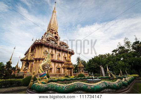 Naga Sculpture In The Garden With Holy Pagoda Of Chalong Temple