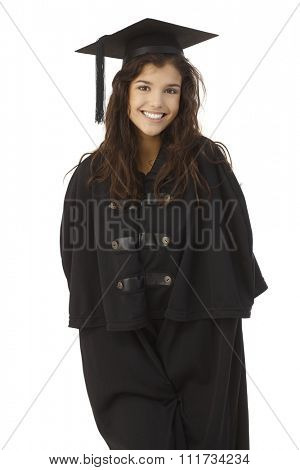 Attractive female graduate smiling in academic dress over white background.
