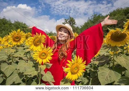 Woman Happy And Enjoy In Sunflower Field