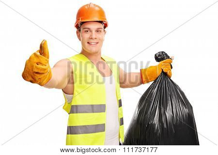 Young male waste collector holding a trash bag and giving a thumb up isolated on white background