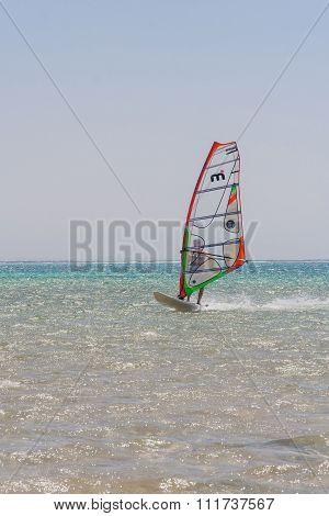 Windsurfer rides in a sea.