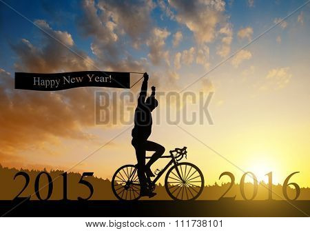 Cyclist on bicycle at sunset. Forward to the New Year 2016