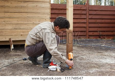 Man Preparing Spray Gun For Painting