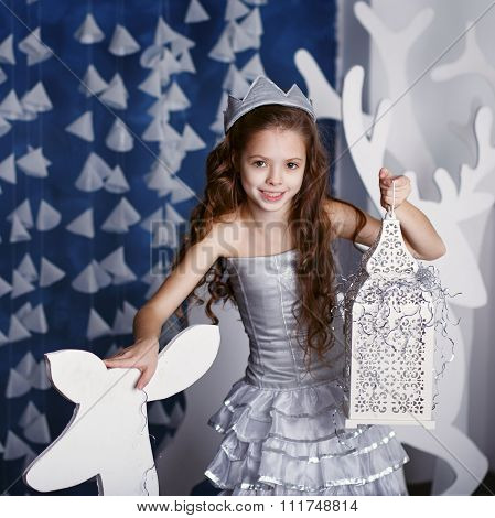 Portrait Of Beautiful Little Girl With Long Curly Hair With Crown.