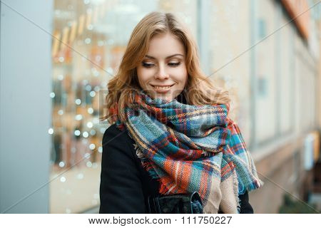 Beautiful Happy Woman With A Vintage Scarf On The Background Of Blue Lights