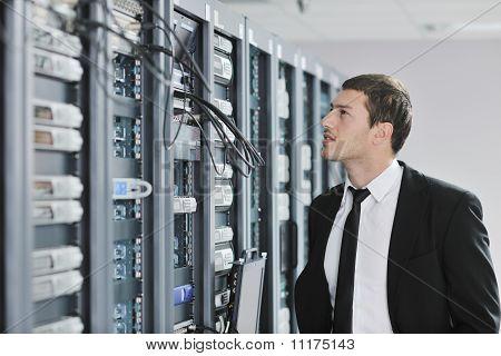 Young Engeneer In Datacenter Server Room