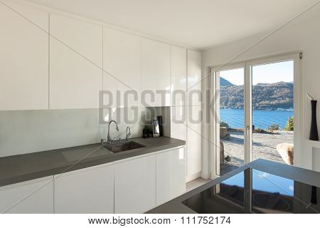 Interior of house, modern kitchen with induction stove