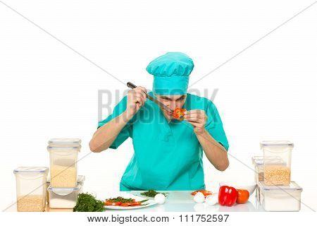 Friendly chef preparing vegetables in his kitchen. pepper loves