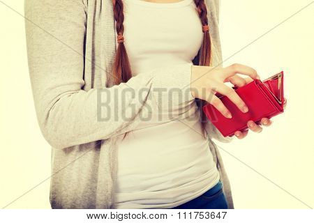 Casual teen woman with a wallet.