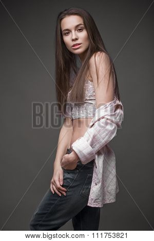 sexy  fashion model with long hair, young European attractive, beautiful eyes, perfect skin is posin