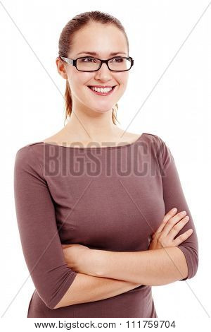 Young beautiful woman wearing black glasses and brown dress standing with crossed arms, looking up and smiling isolated on white background - dreams concept