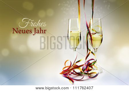 Flutes Champagne Glasses And Colorful Streamers Against A Bokeh Background, German Text Frohes Neues