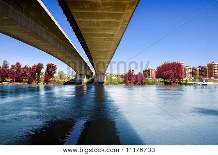 concrete bridge and river