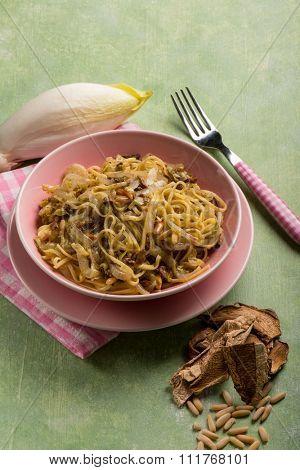 tagliolini with dried mushroom pine nuts and endive salad