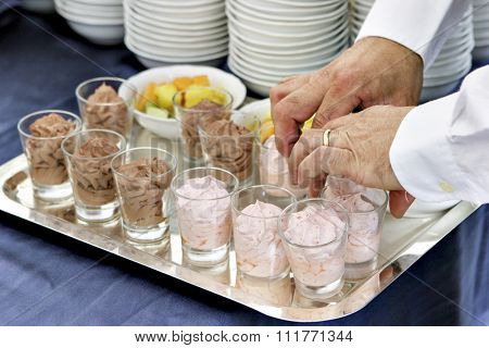 waiter while preparing food for catering