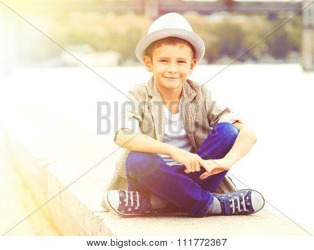 Little boy on the riverside