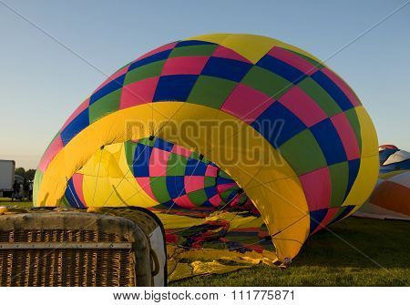 The Envelope Of A Hot Air Balloon Being Inflated On The Ground