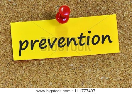Prevention Word On Yellow Notepaper With Cork Background