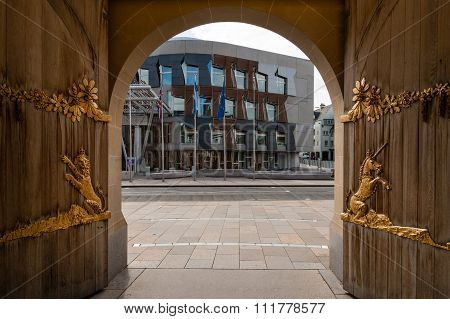 Doors Of The Queen's Gallery Edinburgh And View Of Scottish=h Parliament.
