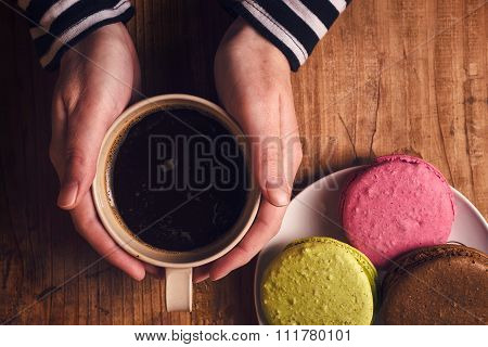 Coffee And Macaron Cookies On Table