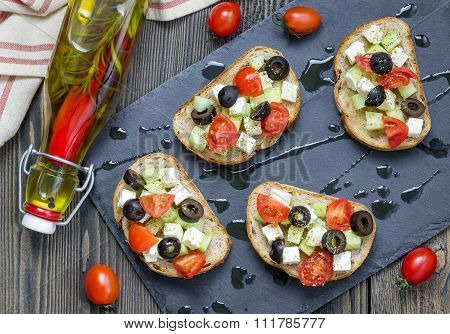 Greek Style Crostini With Feta Cheese, Tomatoes, Cucumber, Olives And Herbs, Top View