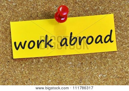 Work Abroad Word On Yellow Notepaper With Cork Background