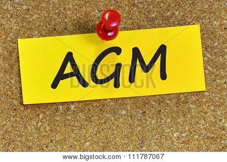 Agm Word On Yellow Notepaper With Cork Background