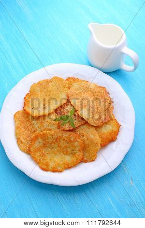 Potato Pancakes in a white plate on a blue background