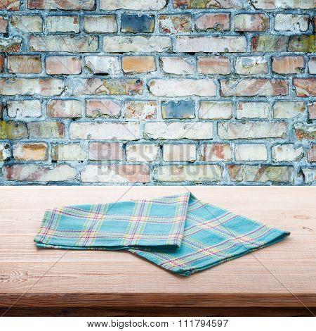 Empty Table And Tablecloth, Gray Brick Wall As Background.