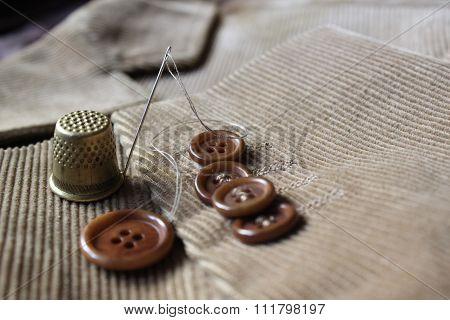 Buttons on the velvet jacket
