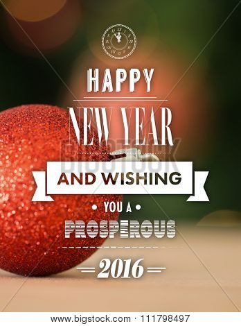 New year graphic against close up of red christmas bauble