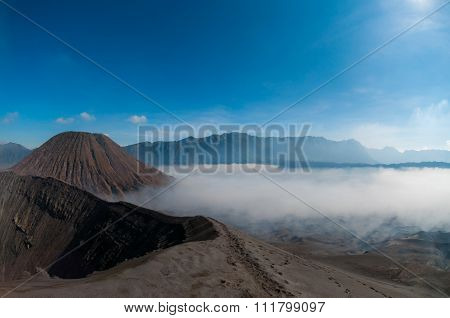Blue Sky Over Mountain and volcano Bromo with smoke sulphur