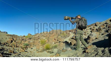 wildlife photographer outdoor in summer in Tiede crater, Tenerife, Spain