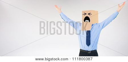 Cheering anonymous businessman against grey background