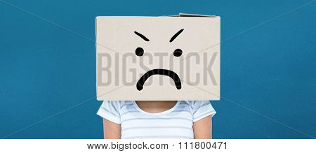 Depressed woman with box over head against blue background
