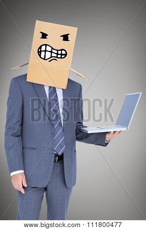 Anonymous businessman against grey vignette