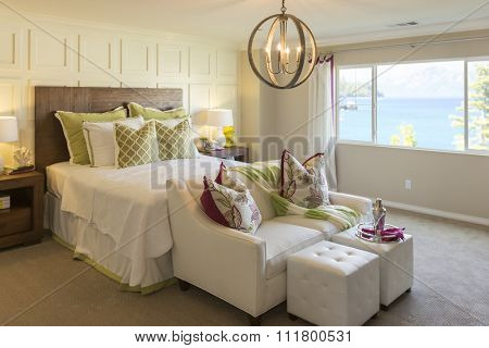 Beautiful Abstract of Inviting Bedroom Interior and Sitting Area.