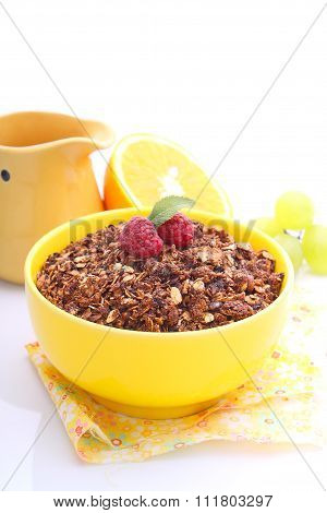 Chocolate Granola In A Yellow Bowl With Berries