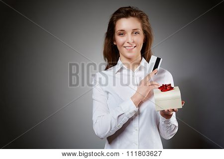 Smiling woman with credit card and gift