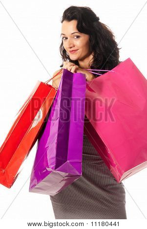 Young Woman With Shopping Bags Standing Isolated On White Background