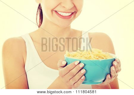 Young woman holding a bowl of noodles.