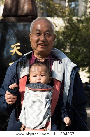Old Asian Men On A Walk With Grandson