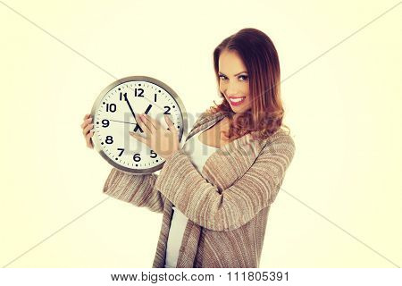 Beautiful woman changes clock leads.