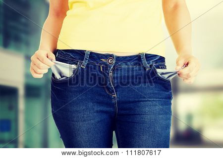 Woman with her empty pockets