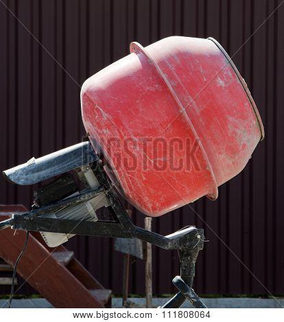Orange Cement Mixer at a construction site