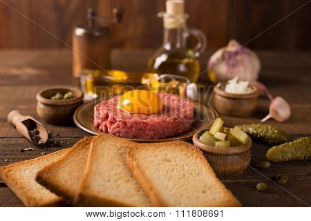 Beef Tartar On Dark Wooden Table