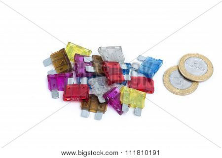Car Fuse. Pile Of Colorful Electrical Automotive Fuses Or Circuit Breakers Isolated On White Backgro
