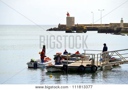 Lagos, Algarve, Portugal - October 28, 2015: Boats on the Bensafrim river in Lagos harbour