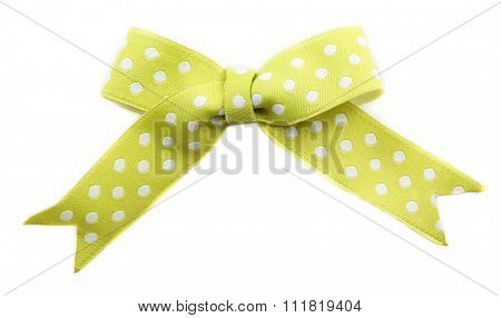 Green dotted bow isolated on white background